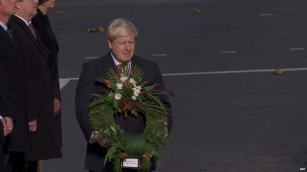 Foreign Secretary Boris Johnson with a wreath of tussock grass, slipper spurge and old father live forever, in a wreath for the overseas territories put together by Kew Gardens