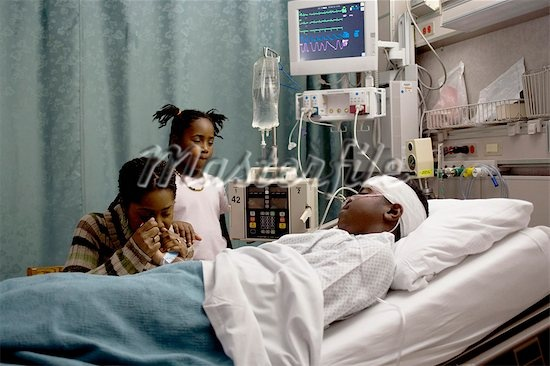 Picture Of A Black Woman In A Hospital Bed