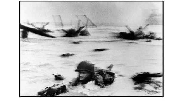 This image of a GI struggling to shore fronted Capa's memoir, Slightly Out Of Focus