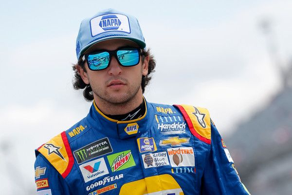 Chase Elliott Photos Photos - Chase Elliott, driver of the #24 NAPA Auto Parts Throwback Chevrolet, walks on the grid during qualifying for the Monster Energy NASCAR Cup Series Bojangles' Southern 500 at Darlington Raceway on September 2, 2017 in Darlington, South Carolina. - Darlington Raceway - Day 2