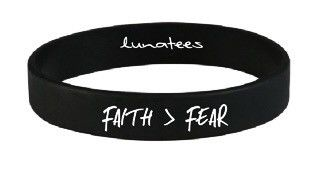 Black rubber performance bracelet. The words Faith>Fear imprinted in the…