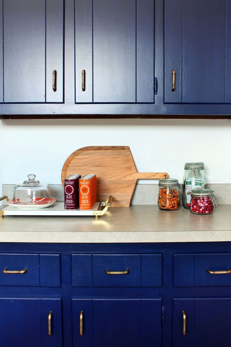 Gliddens Rich Navy Covers The Newly Painted Cabinetry Antique Brass Hardware Finishes Look Kitchen CabinetsBlue