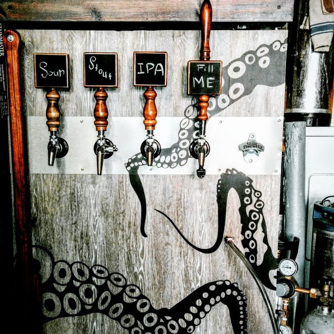 How to convert an old refrigerator in to a beer kegerator! I love the art!