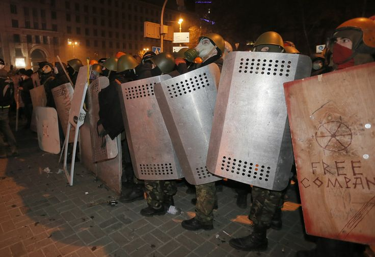 Renewed Protest in Ukraine - Protesters with both improvised shields and shields taken from riot police prepare to clash with police in Kiev, on January 19, 2014.
