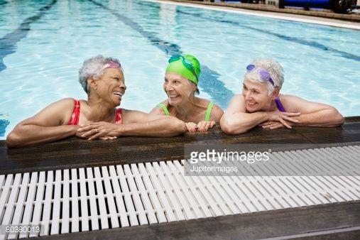 Stock Photo : Smiling senior women in pool