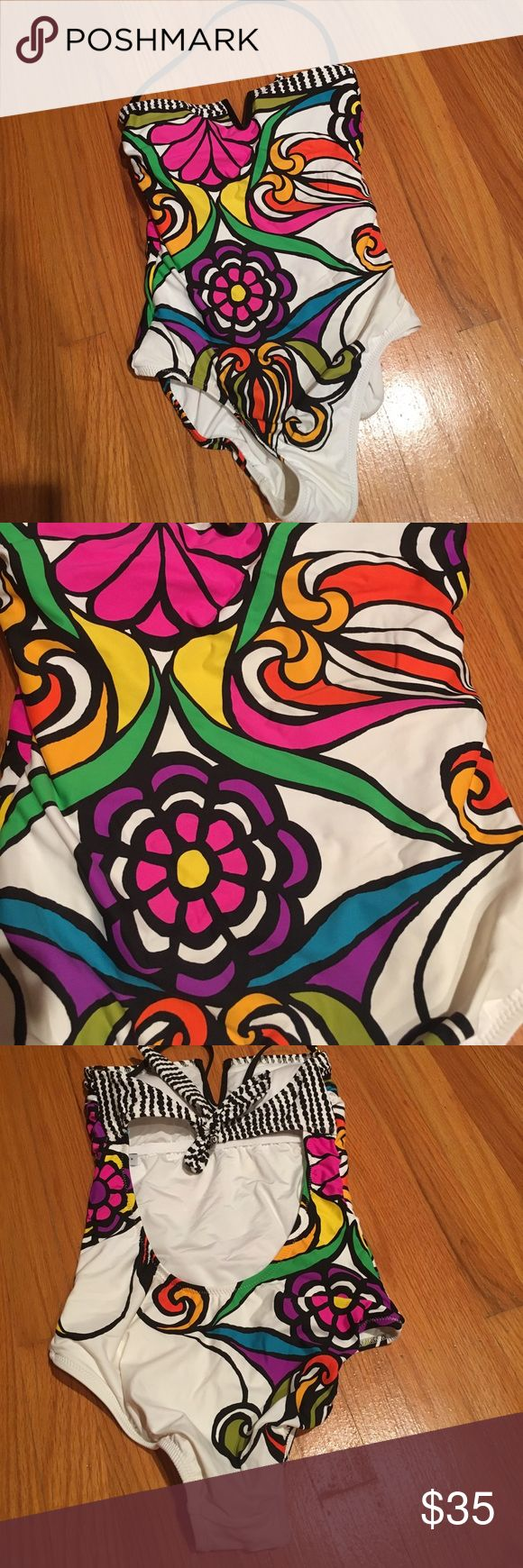Trina Turk size 4 bathing suit NWOT Beautiful and colorful Trina turk bathing suit. I took off tags and washed but never wore. Colorful. Fully lined. Removable padding. Trina Turk Swim One Pieces