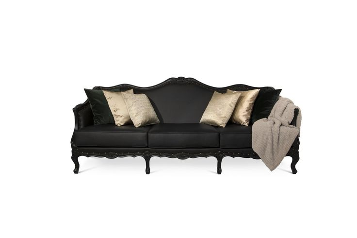 OTTAWA Sofa depicts a sense of contrast by combining curves, elegant shapes and carved wood details with a dramatic color that will make a statement in any living room set. | Modern Sofas. Living Room Furniture Set. #modernsofas #livingroomset #leathersofa Discover more: https://www.brabbu.com/en/upholstery/ottawa-sofa/