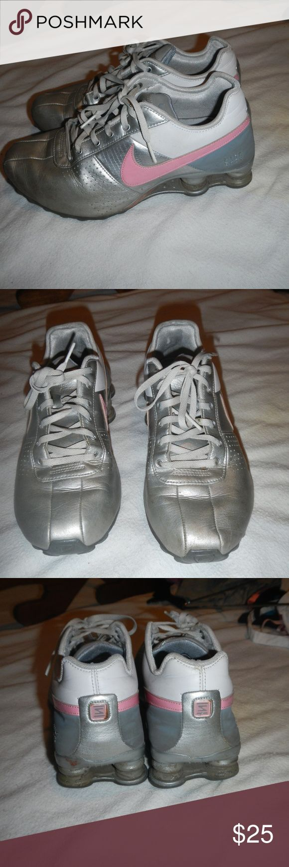 Silver/White/Pink Nike Shocks Gently worn Nike Shocks in good condition.  Could use a little cleaning.  Silver with white & pastel pink accents. Nike Shoes Athletic Shoes