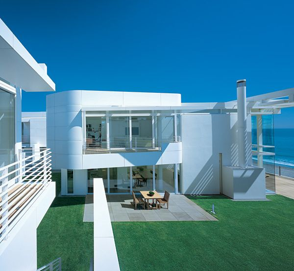 luxury beach houses oceanfront design with white exteriors and interiors