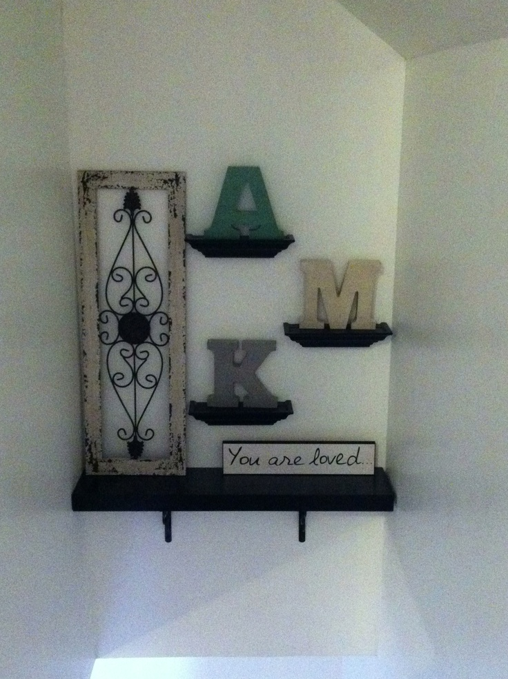 Stairwell decor that encompasses our children with initials. #homegoods #tjmaxx