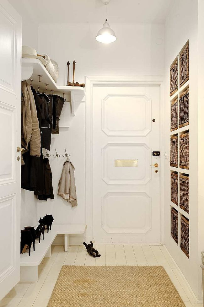 Beautiful, organized entry hallway with hooks, shelves and shoe storage.