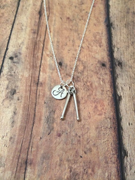 This listing is for a hand stamped initial necklace featuring a 9/10 x 1/5…