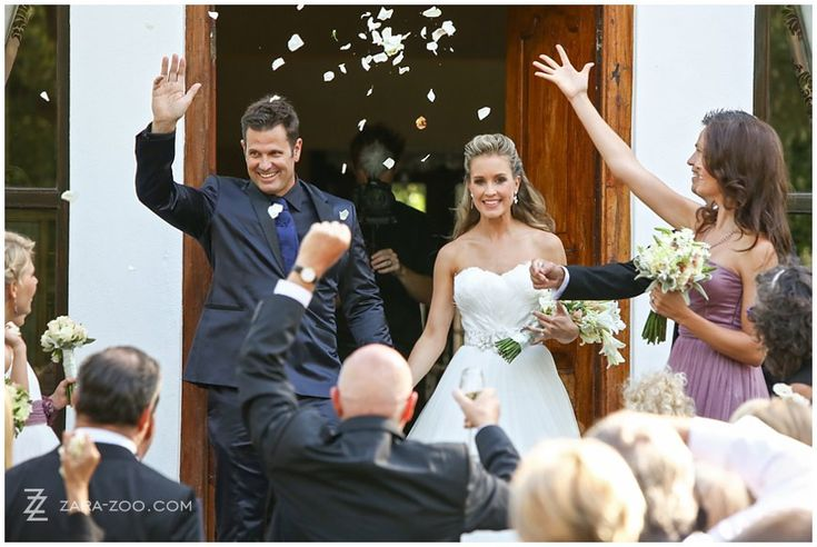 Rose petals was used at confetti at this #wedding at #Molenvliet Wine Estate near Stellenbosch, South Africa.  Rose petals is a GREEN alternative for #confetti as it is bio degradable. See more of this wedding on the ZaraZoo Photography blog http://www.zara-zoo.com/blog/molenvliet-wedding-photos-stellenbosch