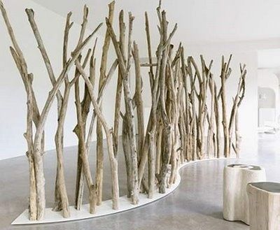 Room divider with natural materials (sticks). Would love to make child hight dividers for my classroom.