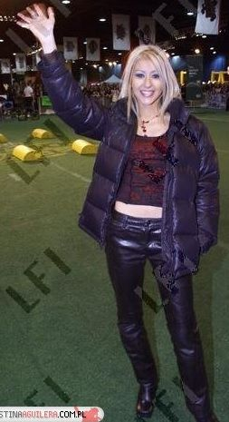 Christina Aguilera Black Dkny Down Jacket And Leather Pants