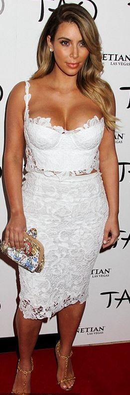 Kim Kardashian: Dress and purse – Dolce & Gabbana  Shoes – Tom Ford