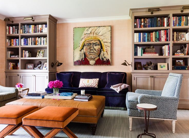 1.Navy & Orange Lots of family time is spent in the library of this Rye, New York, home, so designer Sara Gilbane packed in as much seating as possible and chose rich jewel tone colors, like the navy corduroy on the sofa, and warm autumnal shades for extra coziness. See more of the home here >