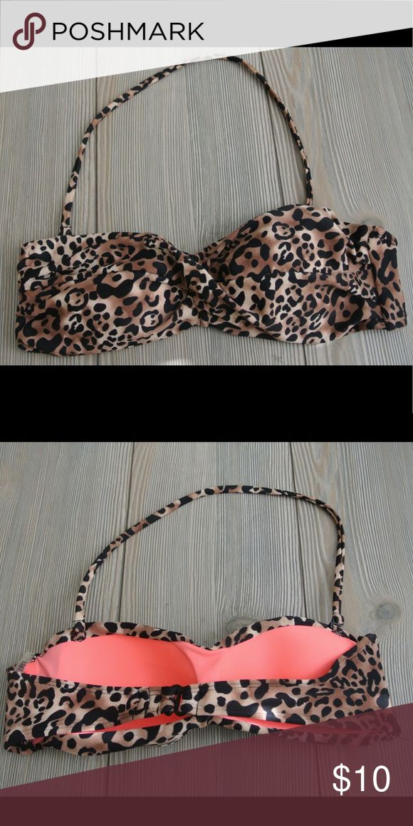 """Forever 21 Animal Print Bandeau bikini top small Forever 21 bandeau bikini top. Cheetah animal print, twisted front. Back clasp and removable strap. Lined and shaped front. I cut off tags and size tag but never worn other than trying on. Top measures 12"""" across. See my closet for matching bottoms! Forever 21 Swim Bikinis"""