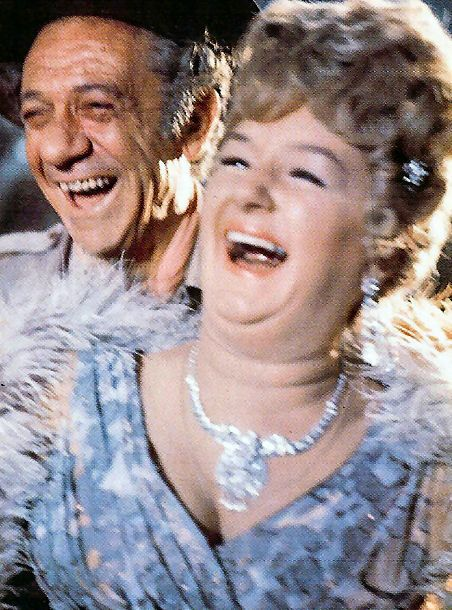 Sid James as 'Bill Boosey' and Joan Sims as 'Lady Evelyn Bagley' have a laugh between takes in 'Carry On Up The Jungle' (1970)