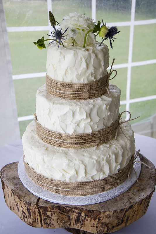 rustic wedding cake and wooden tree cake stand decorated with burlap