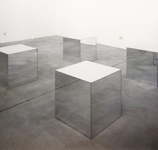 Robert Morris, untitled (Mirrored Cubes), 1965 •Studied sculpture, dance and theatre.  •Involved in Fluxus •Interested in Tatlin, Jasper Johns and time based art. •Has all the elements of the Tony Smith Die, but mirrors reflect you and gallery surround. Work absorbs you into its structure.