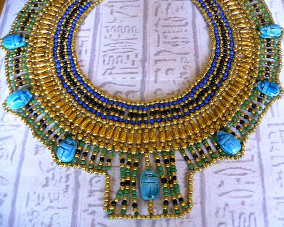 Handmade in Egypt by local craftsman. This outstanding and stunning necklace is handmade in true ancient Egyptian tradition with seed beads and genuine handmade Egyptian scarab beads.    The perfect piece of jewelry for an Egyptian fancy dress costume. $