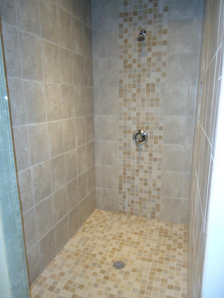 We utilized daltile sandalo castillian gray 12x12 with for 9x12 bathroom design