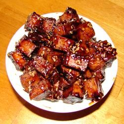Baked Tofu Bites are marinated in soy sauce, maple syrup, ketchup, vinegar, and seasonings, and then baked in the oven. The tofu can be used as a hot or cold snack or as a salad topping. Use organic, reduced sugar, low carb ketchup