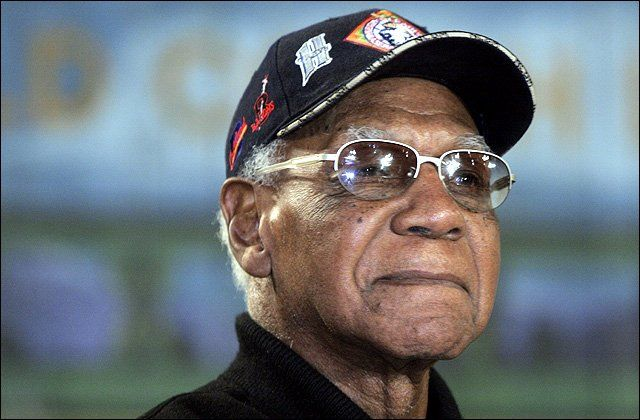 Kansas City's Buck O'Neil listens to remarks during a press conference for the Negro League's Baseball Museum.