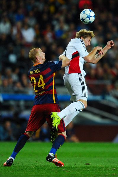 Stefan Kiessling of Bayer 04 Leverkusen competes for the ball with Jeremy Mathieu of FC Barcelona the UEFA Champions League Group E match between FC Barcelona and Bayer 04 Leverkusen on September 29, 2015 in Barcelona, Catalonia.