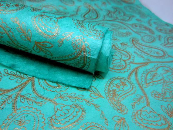 Large sheet (500mmx750mm) Mint Green and Gold Paisley Design Comes rolled in a postal tube - 50x75cm - - Made from the Lokta plant - - Vegetable Dyed - - 40 Gram Weight - - Handmade Paper is very fibrous & textured, making each sheet unique - This beautiful handmade paper is made by