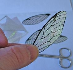 how to: iridescent fairy wings ...looks like iridescent paper, scissors and black marking pen