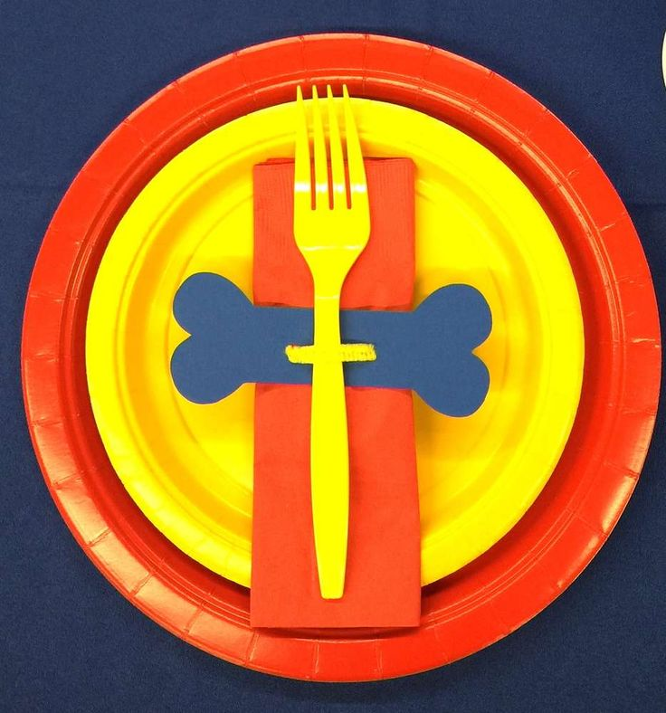 Make a PAW Patrol party setting using primary color party supplies and a bone-shaped napkin ring. Your preschooler will love it!