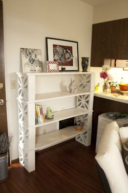 Shelf made out of wood planks & cinder blocks shelves + concrete   block furniture