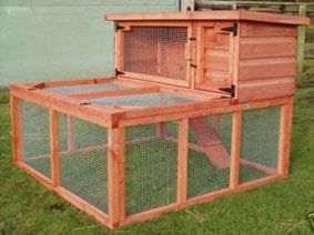 rabbit hutch only with cold frame lettuce, kale, spinach, celery, and perennial flowers garden on top