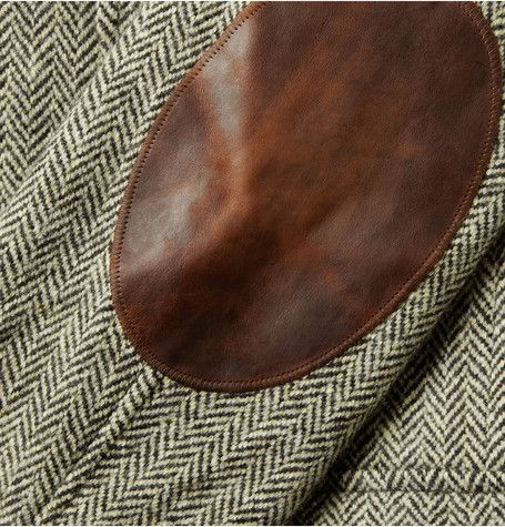 herringbone with leather elbow patches.