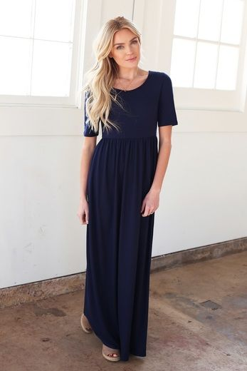 A classic design, this modest maxi dress from Omika is back in navy, back by popular demand. With a high neckline, half sleeves, and a classic shade, this is a style you can wear anywhere. Omika ships modest dresses worldwide from Perth Australia.