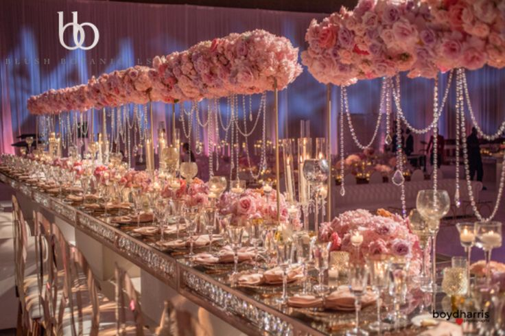 WAGS Miami star marries Corey Liuget of the Chargers in this glamorous pink and pastel San Diego wedding by Blush Botanicals, Details Defined, Hire Elegance.  Pink Wedding, over the top wedding, flower chandelier, chuppah, flower canopy.    photo: Boyd Harris