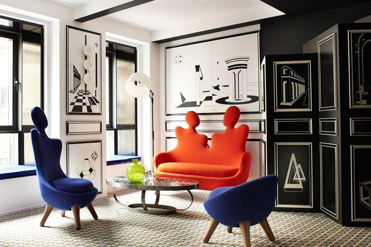 Hotel Montata - The suite Noir Métaphysique features a carpet by Codimat in an eye print; chairs and 'Conversation Canapé' by Maison Darré.