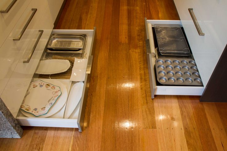 Kickboard drawers for storage of platters and baking trays. Use every inch of space in your kitchen. www.thekitchendesigncentre.com.au