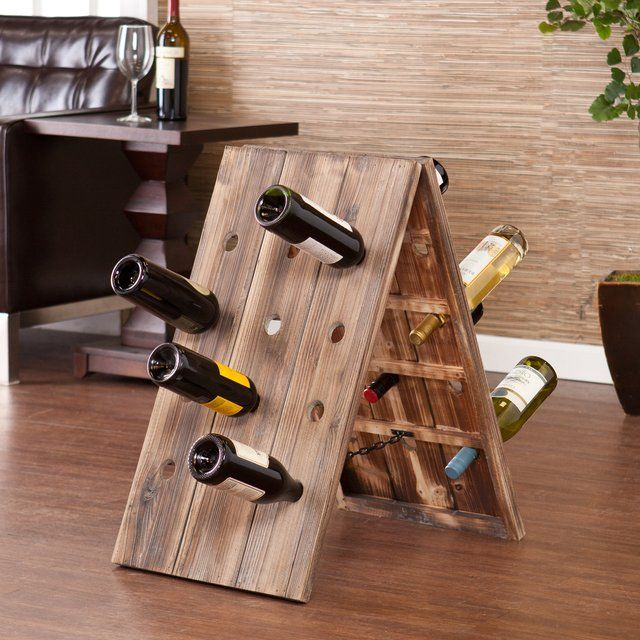 24-Bottle Riddling Rack Wine Holder / The 24-Bottle Riddling Rack Wine Holder is an A-frame design to hold your wine bottles and make it look good. http://thegadgetflow.com/portfolio/24-bottle-riddling-rack-wine-holder/