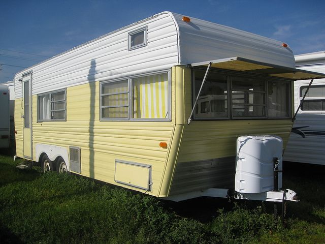 sunny vintage camper........very cute inside and out.  Want to redo one one day SOON!!