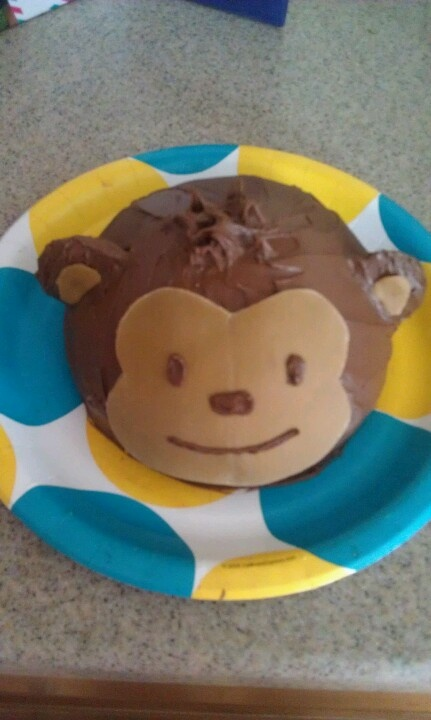 My mod monkey smash cake using 1/2 of a wilton ball pan, chocolate icing and fondant face. Ears are vanilla wafers frosted and pushed into cake
