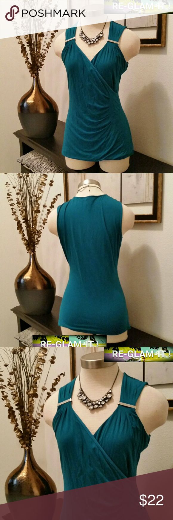 WHBM..NEW LISTING...BEAUTIFUL TURQUOISE TOP... ...ADDING INFO SOON..EXCELLENT CONDITION  ...NORMAL WEAR...NO FLAWS.. ...COLOR ....TEAL ...TURQUOISE  ...A MUST HAVEEE. ...LOOSE FEEL ...LOW DROP FRONT ...AS SHOWN White House Black Market Tops Blouses