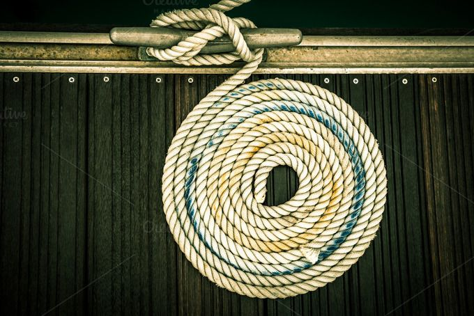 Check out A mooring rope by Dvoevnore travel photos on Creative Market