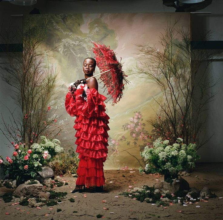Look 3: Danai Gurira from Rodarte Fall Winter 2018 Portrait Series  In a black and red flocked silk tiered ruffle jacket, a black sequin and red and black polka dot strapless bustier with flower details, and a black and red flocked crinkle silk chiffon ruffle skirt