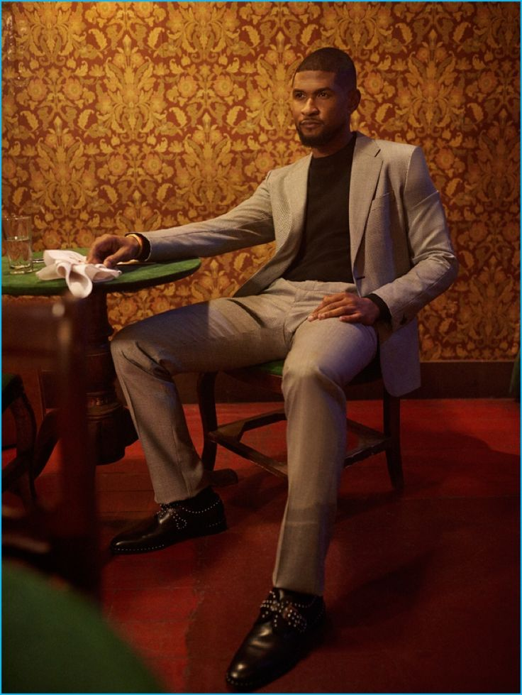 Usher pictured in a Versace suit with a Michael Kors t-shirt and Givenchy…