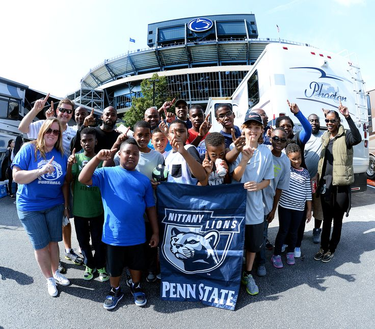 PENN STATE – FANS AND ALUMNI – Young Penn State fans tailgate in parking lot below