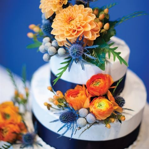 great colors, pretty cake - love dahlias and ranunculus; and the purple/blue spiky things are kind of neat