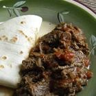 Carne Guisada .... sounds good.  I have a load of grass-fed Angus arm roasts in the freezer!